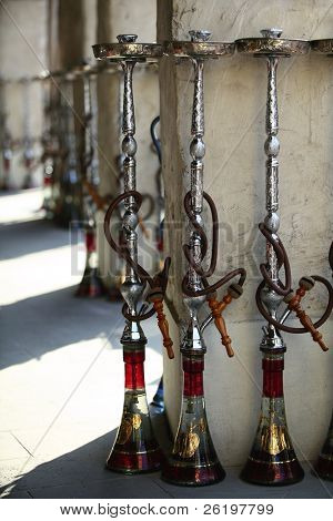 Shisha (hookah) pipes lined up outside a restaurant in Doha's Souq Waqif ready for customers. Shisha smoking has become popular among expatriates as well as locals