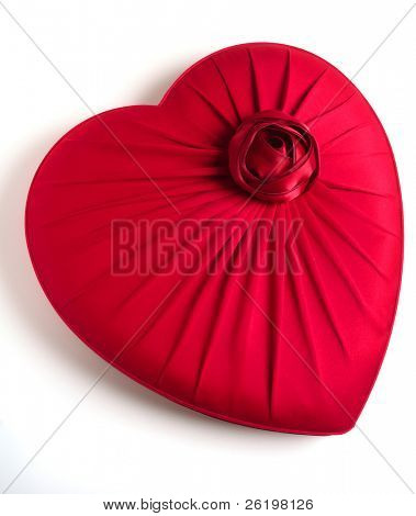 A red, heart-shaped box with an imitation rose on it, ideal for a gift to a loved one, over white with a light shadow
