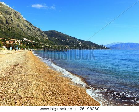 Barbati beach on the east coast of Corfu, Greece. The huge tourist beach (seen here out of season) has the prestigious EU Blue Flag award for cleanliness. The Albanian mountains are in the background.