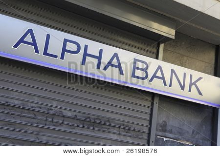 HERAKLION, GREECE - JULY 27: A branch of Alpha Bank in Heraklion (Iraklio), Crete. Alpha Bank's part of  Greek sovereign debt was put at 4.6 billion euros in June 2011. July 27, 2010 in Heraklion, Crete, Greece