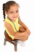 foto of happy kids  - Adorable 3 year old hispanic african american girl sitting on stool over white background - JPG