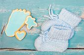 Flatlay, Best Whishes For The Newborn Baby Boy, Blue Cookies And Shoes On Wooden Table poster