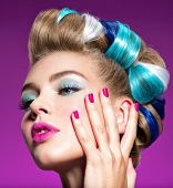 Fashion portrait of a beautiful woman with blue makeup and pink fingernails.  Beautiful fashion mode poster