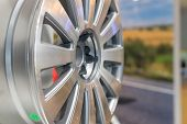 Metal Disc Wheel For The Car At An Exhibition.selective Focus.modern Store With Alloy Wheels And Tir poster