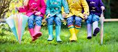 Group Of Kids In Rain Boots. Colorful Footwear For Children. Boys And Girl In Rainbow Wellies And Du poster