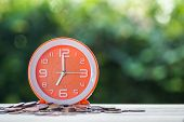 Time And Money Investment, Deadline Loan Money Concept : Time On Coins On Table With Green Bokeh As  poster