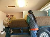 Two Workers Moving Love Seat