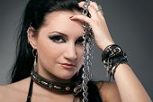 picture of sadism  - young naked woman in chain on black background - JPG