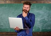 Distance Education Concept. Surfing Internet. Hipster Teacher Wear Eyeglasses And Necktie Holds Lapt poster