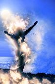 A Lone Woman Raising Her Arms Spiritually On Fire Facing A Powerful Wave On The Cliffs Edge poster