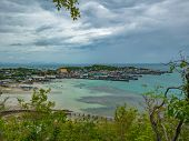 Viewpoint On The Mountain With Fisherman Townscape With Idyllic Ocean And Rainy Cloud Sky In Vacatio poster