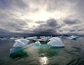 Sunset over the famous Jokulsarlon glacier lake in Iceland, where the icebergs, originating from the