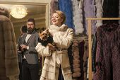 Sensual Woman In Fur Coat With Man, Shopping, Seller And Customer. Sensual Woman With Yorkshire Terr poster