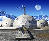 Geodomes in the tundra. The moon is viewable in the sky. No people are viewable. Squarely framed sho