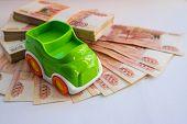 Car Loan.concept Of Savings To Buy A Car Money.miniature Car Model Near Cash Money , Russian Rubles, poster