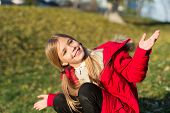 Feel Happy Sunny Autumn Day. Girl Happy Wear Coat With Hood Enjoy Fall Nature. Child Wear Coat For F poster