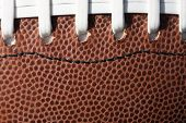 foto of ncaa  - Football laces and texture background - JPG