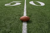 picture of ncaa  - American football near the fifty yard line - JPG