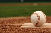 stock photo of pitcher  - Baseball on the Pitchers Mound with room for copy - JPG