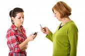 mother and daughter use their mobile phones, daughter shows something on her mobile, isolated on whi