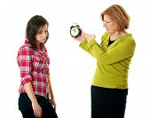 stock photo of disrespect  - mother warn her daughter for being late - JPG