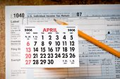 picture of lien  - Federal tax form below a calendar showing the month of April 2008 - JPG