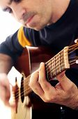 stock photo of musical instrument string  - Man playing a musical instrument accoustic guitar - JPG