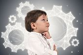 Adorable Little Boy In White Shirt Thinking Standing Near A Gray Wall With Polygonal Cogwheels Drawn poster