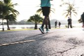 Blur Of Runners Jogging In Park Early Morning Near Riverside For Good Healthy, Run Fitness Group At  poster