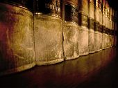 picture of hardcover book  - Row of old leather law books on a shelf - JPG