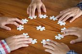 Hands Of Diverse People Assembling Jigsaw Puzzle, Youth Team Put Pieces Together Searching For Right poster