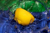 stock photo of crown green bowls  - Splash with fresh lemon - JPG