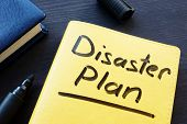 Disaster Recovery Plan Written On A Yellow Note. poster