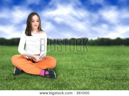 Beautiful Girl Reading Outdoors