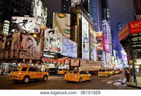 New York City - Sept 5: Times Square, Featured With Broadway Theaters, Taxi Cabs And Animated Led Si
