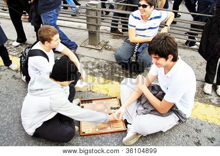 Children play backgammon on the bridge