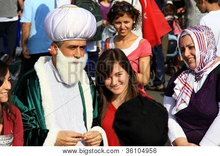 People posing with Hodja, Nasreddin