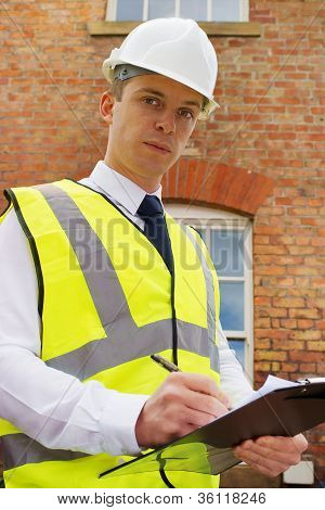 Construction Professional With Clipboard, An Inspector, Surveyor Or Site Boss.