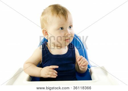 A Young Gray-eyed Child Feeding Porridge