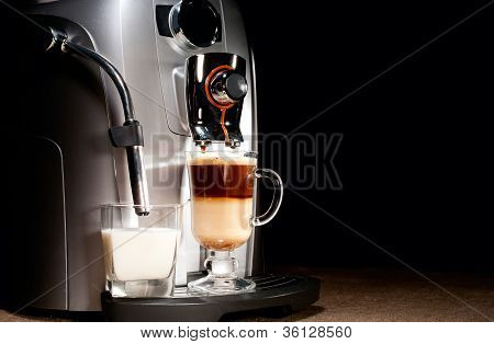 Coffee Machine With Milk Glass And Cappuccino