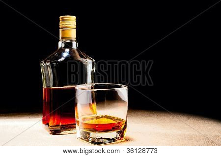 Glass Of Whisky And Bottle