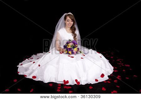 Bride Surrounded By Rose Petals
