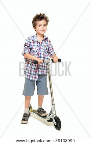 Naughty Hairy Little Boy In Shorts And Shirt With Scooter