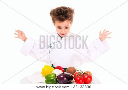 Little Boy Chef In Uniform Cooking Vegatables