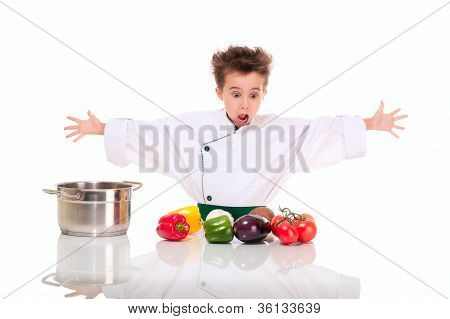 Little Boy Chef In Uniform Cooking Vegatables Shocked