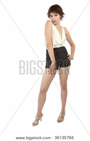 Glamorous Sexy Young Woman Stands Flirtatiously With Hand On Hip.