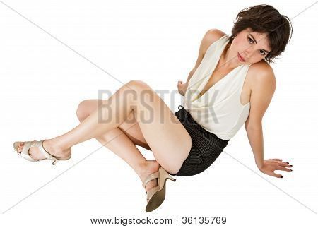 Glamorous Dark-haired Young Woman Seated On Floor Leaning Back