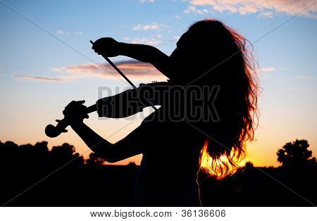 Woman Silhouette Playing Violin In Sunset Light