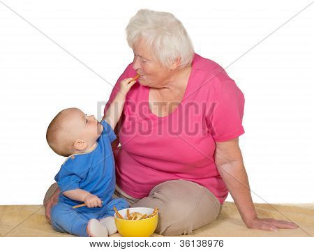 Tender Moment Between Baby And Grandmother