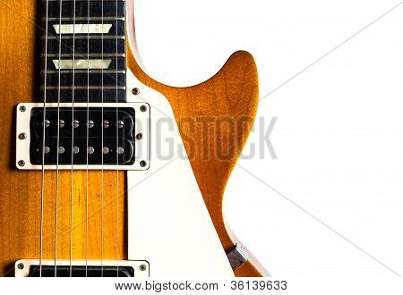 Old Electric Guitar On White Background